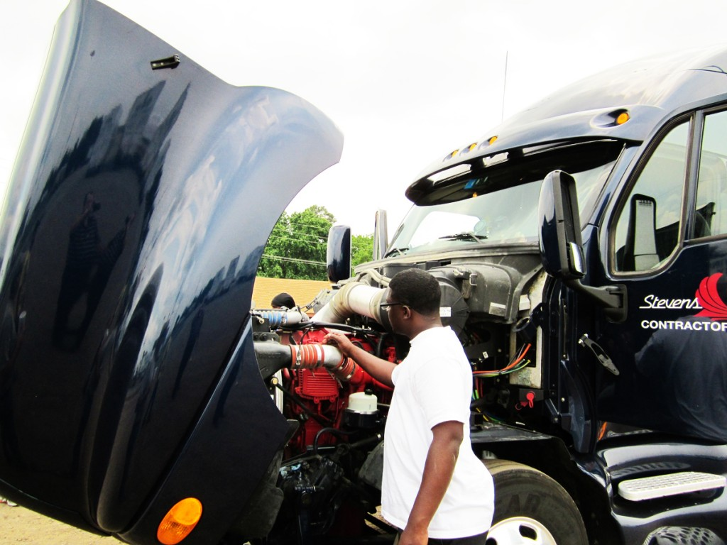 LaDerrick Washington checks out engine of visiting truck