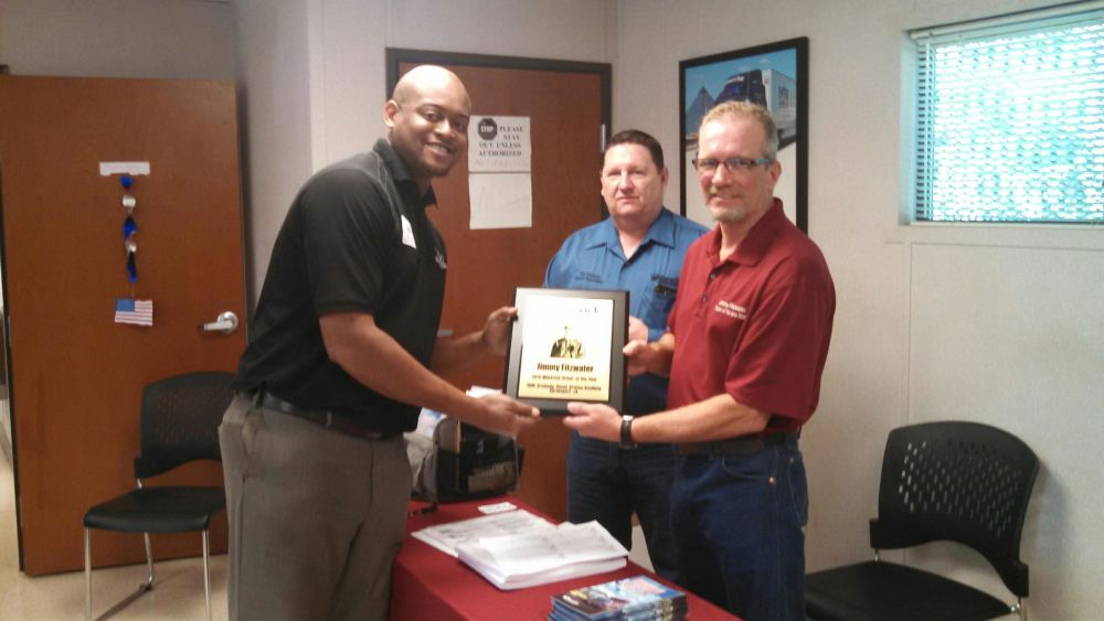Director of Training and Placement Steffon Jones receives 2014 driver of the yar award