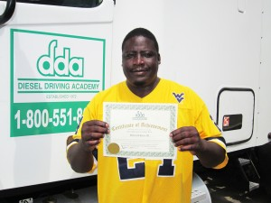 Detroit Harris showing his CDL training certificate